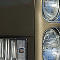 1966 Cadillac Emblem And Headlight by Jill Reger