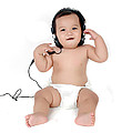 A Chubby Little Girl Listen To Music With Headphones  by Antoni Halim
