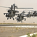 A Group Of Ah-64d Apache Helicopters by Terry Moore