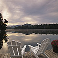 A Pair Of Adirondack Chairs On A Dock by Michael Melford
