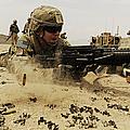 A Soldier Firing His Mk-48 Machine Gun by Stocktrek Images