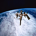 A Space Station In Orbit Above The Earth by Stockbyte