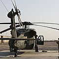 A Uh-60 Black Hawk Helicopter Parked by Terry Moore