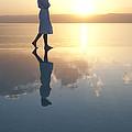 A Woman Enjoys The Warm Sun On The Edge by Taylor S. Kennedy