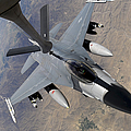 An F-16 Fighting Falcon Receives Fuel by Stocktrek Images