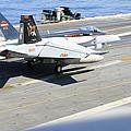 An Fa-18e Super Hornet Lands Aboard by Stocktrek Images