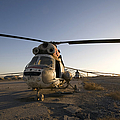 An Iraqi Helicopter Sits On The Flight by Terry Moore