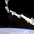 Astronaut Anchored To A Foot Restraint by Stocktrek Images