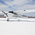 Cessna Aircraft On Bonneville Salt Flats by Paul Edmondson