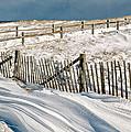 Drifting Snow Along The Beach Fences At Nauset Beach In Orleans  by Matt Suess