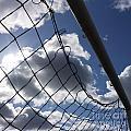 Goal Against Cloudy Sky. by Bernard Jaubert