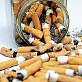 Jar Overflowing With Cigarette Butts by Sami Sarkis