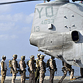 Marines Board A Ch-46e Sea Knight by Stocktrek Images