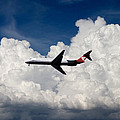 Passenger Jet And Clouds by Carl Purcell