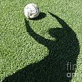 Shadow Playing Football by Mats Silvan