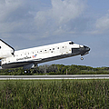Space Shuttle Discovery Lands On Runway by Stocktrek Images