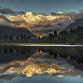 Sunset Reflection Of Lake Matheson by Colin Monteath