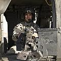 A Uh-60 Black Hawk Door Gunner Manning by Terry Moore