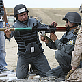 An Afghan Police Student Loads A Rpg-7 by Terry Moore