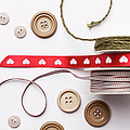 Close Up Of Ribbon, String And Buttons by Nils Hendrik Mueller