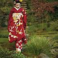 Kimono-clad Geisha In A Park by Justin Guariglia