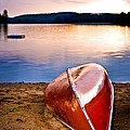 Lake Sunset With Canoe On Beach by Elena Elisseeva