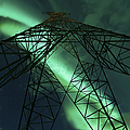 Powerlines And Aurora Borealis by Arild Heitmann