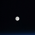 The Moon And Earths Atmosphere by Stocktrek Images