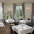 Upscale Hotel Dining Room by Jaak Nilson