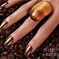 Woman Hands In Coffee Beans by Oleksiy Maksymenko