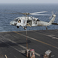 A Mh-60s Knighthawk Conducts A Vertical by Gert Kromhout