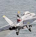 An Fa-18f Super Hornet Launches by Stocktrek Images