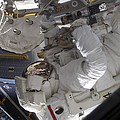 Astronaut Working On The International by Stocktrek Images