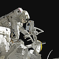 Astronauts Working On The International by Stocktrek Images