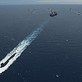 Carrier Strike Group Formation Of Ships by Stocktrek Images