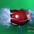 Bullet Hitting An Apple by Ted Kinsman