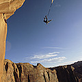 A Base Jumper Leaping With A Parachute by Jimmy Chin