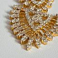 A Beautiful Gold And Diamond Pendant On A White Background by Ashish Agarwal