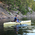 A Boy Kayaking by Ted Kinsman