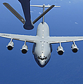 A C-17 Globemaster IIi Approaches by Stocktrek Images