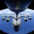 A C-17 Globemaster IIi Receives Fuel by Stocktrek Images