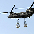 A Ch-47 Chinook Carrying Sandbags by Stocktrek Images