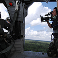 A Cinematographer Videotapes A Soldier by Stocktrek Images