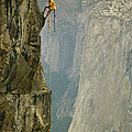 A Climber Makes His Way Up A Rock Face by Bill Hatcher