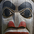 A Close View Of The Carvings Of A Totem by Taylor S. Kennedy