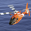 A Coast Guard Hh-65a Dolphin Rescue by Stocktrek Images