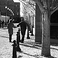 A Couple Walking Together Holding Hands Downtown Asheville by Gray  Artus
