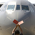 A Crew Chief Marshals In A C-141b by Stocktrek Images