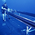 A Crewman Cranks Out The Dry Deck by Michael Wood