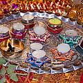 A Decorated Hindu Prayer Thaali With Wax Candles Oil Lamps by Ashish Agarwal